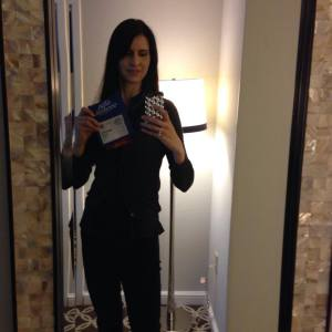 "Even though you can't see it very well, that's me holding up my Agile 2014 badge that says ""Board Member"""