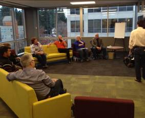 The Agile Alliance board gathering for the start of our meeting in Bellevue. From near to far, Declan Whelan, Samuel Crescencio, Pat Reed (slightly hidden), Linda Cook, Ola Ellnestam, Rebecca Parsons, Phil Brock (Managing Director, and our facilitator is the one standing. Missing from the photo are Shane Hastie, Juan Banda, and me.